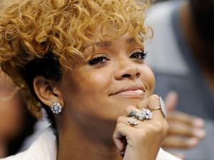 Rihanna smiling moments before last year's assault.
