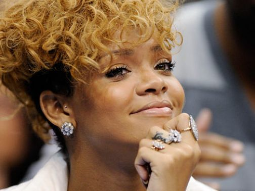 Rihanna attending Grammys alone a year after Chris Brown assault. Brown busy working on Greatist Hits album.